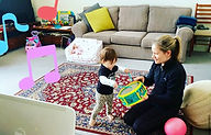 1 year old drumming with mum at music cl