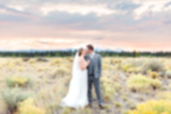 Bride and groom kissing at sunset in Shevlin Park Bend Oregon
