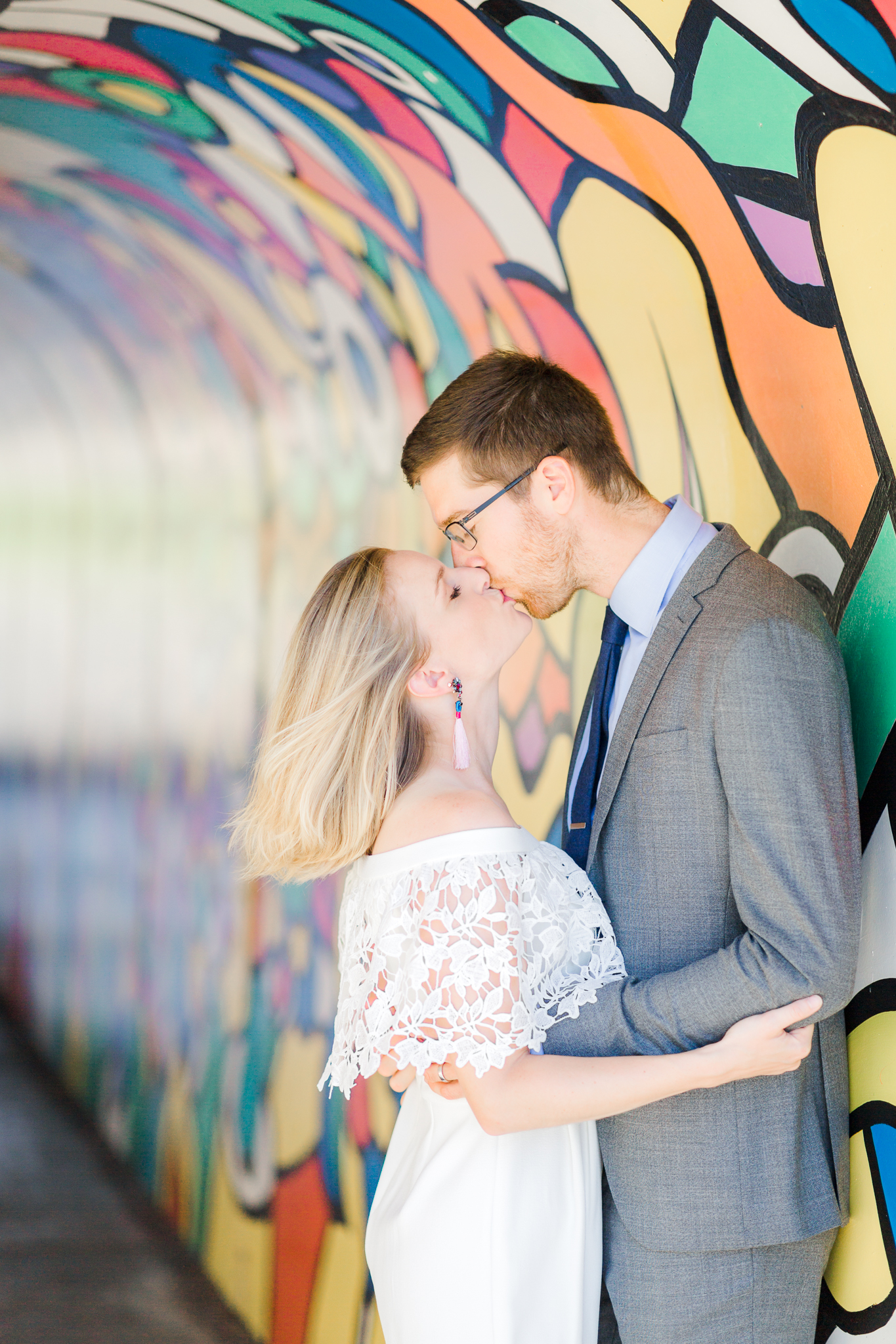 Bride and groom in Old Mill District painted tunnel in Bend oregon