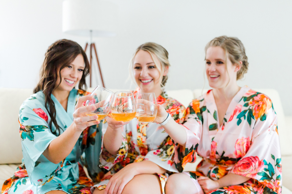 Bridesmaids and bride toasting in robes