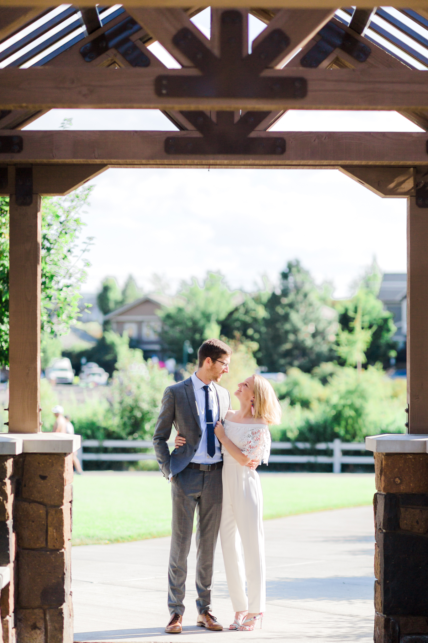Bride in jumpsuit and groom at Miller's Landing in Bend Oregon