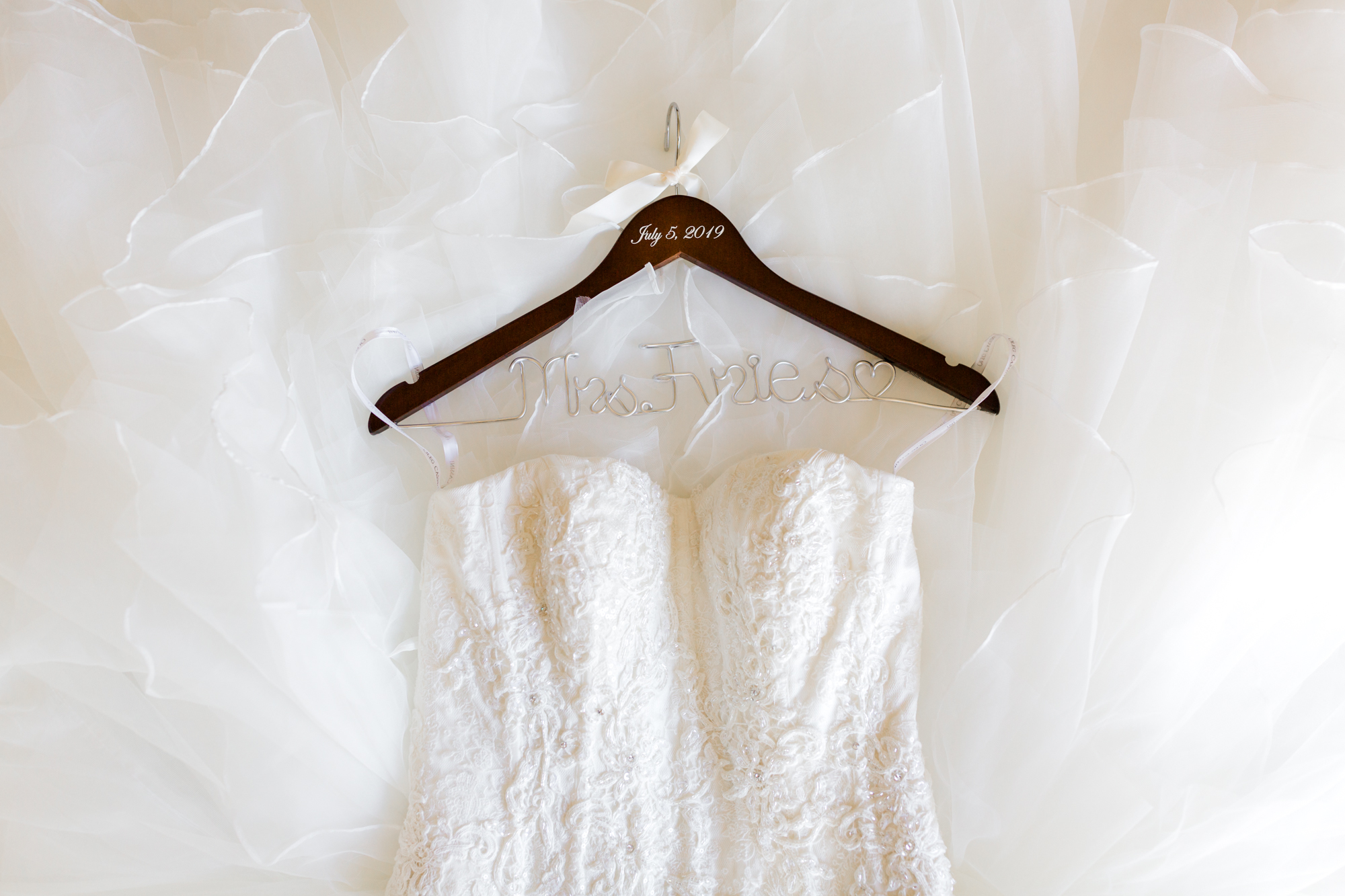 Wedding dress laying on bed