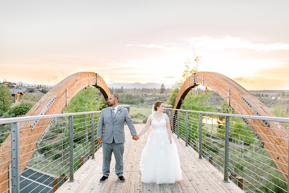 Bride and groom under veil during sunset at Tetherow wedding in Bend, Oregon