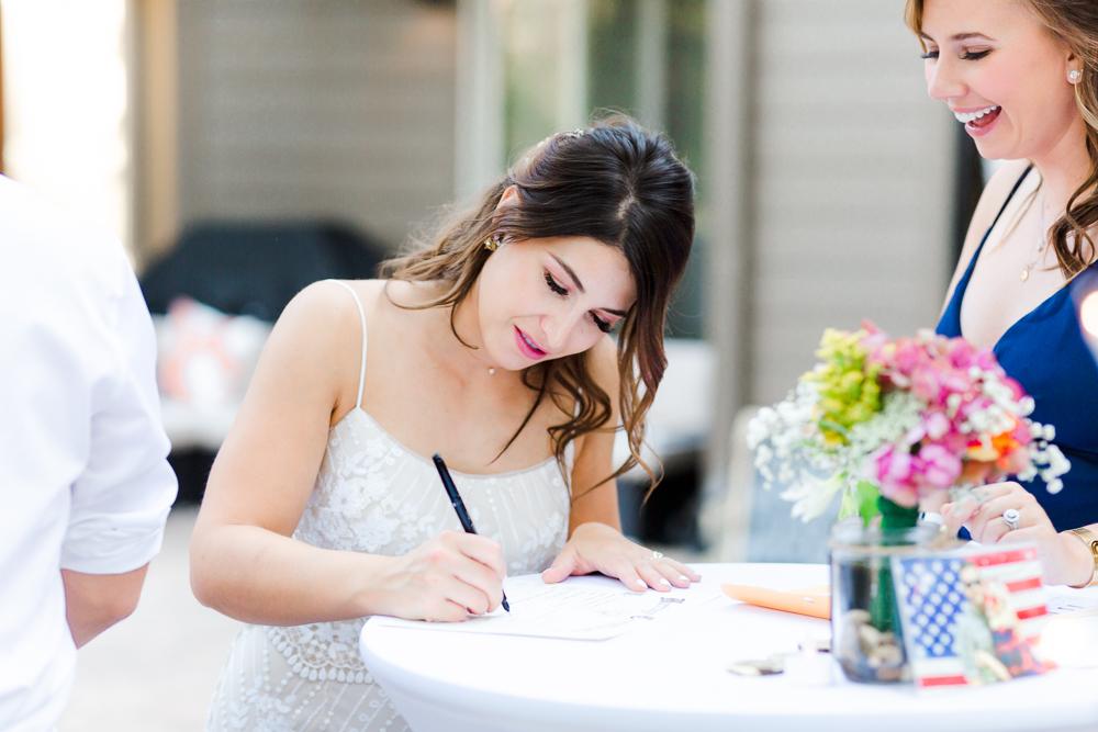 Bride signing marriage certificate in Sunriver Oregon
