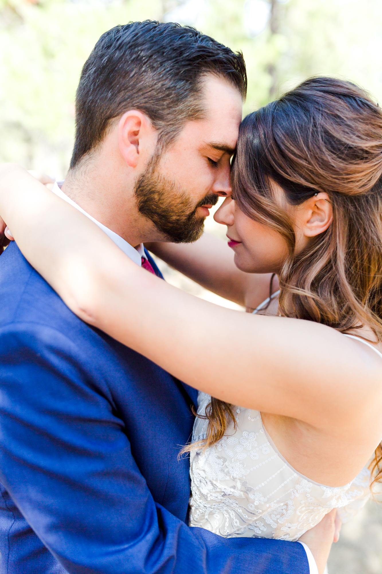 Bride and groom nose to nose in Sunriver
