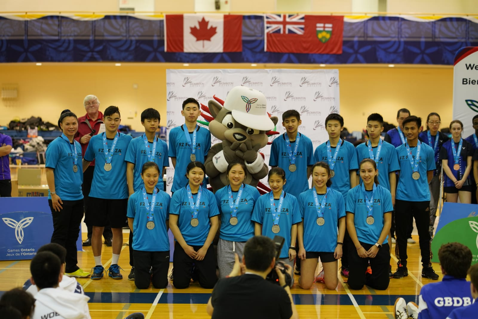 Team photo with silver medals