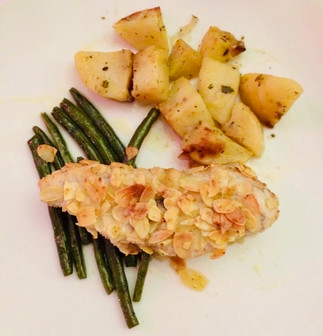 Sea bass fillets in almond crust with roasted potatoes & green beans