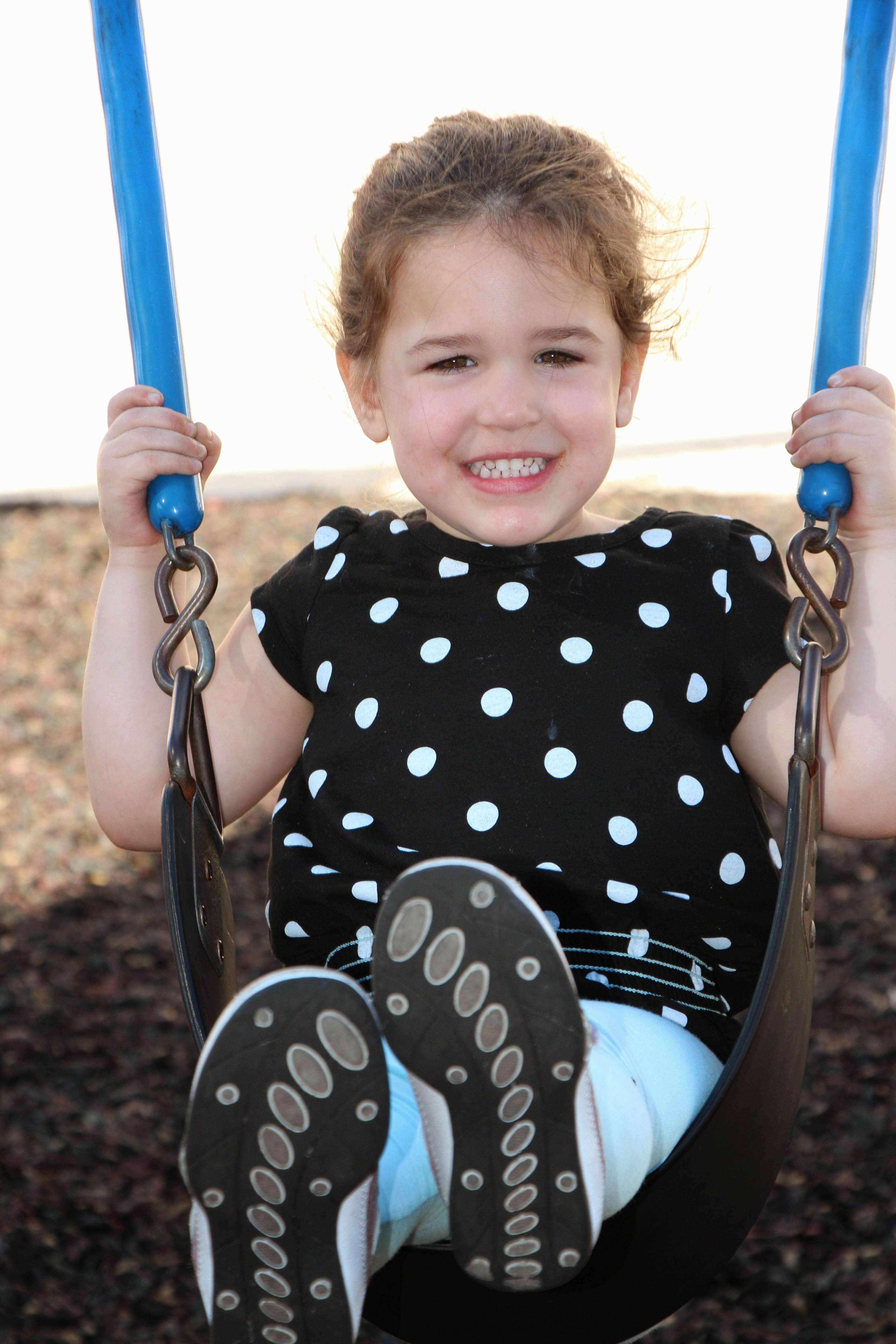 Ellie on swing
