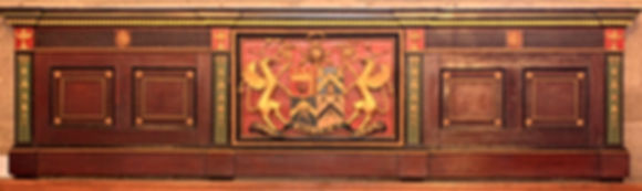53 Carved wooden panel with the insignia