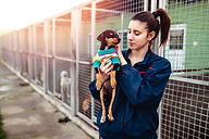 Young woman in dog shelter..jpg