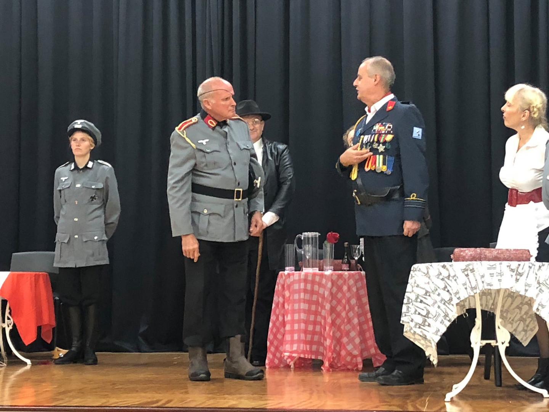General von Schmelling inspects Captain Bertorelli's medals