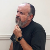The Reverend, played by Richard Boyle