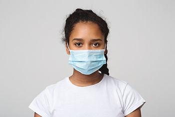teen-black-girl-with-protective-face-mas