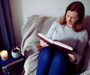 Jen Reading on Sofa