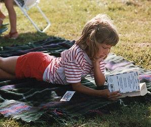 Jen as a child reading