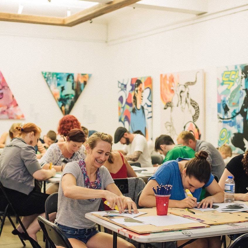 Participants cutting stencils
