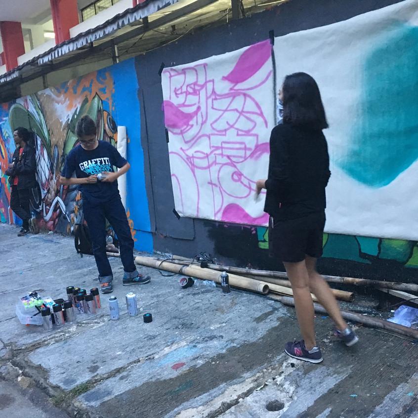 Ladies on wall painting collaborativ