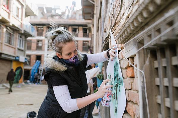 Sarah spray painting