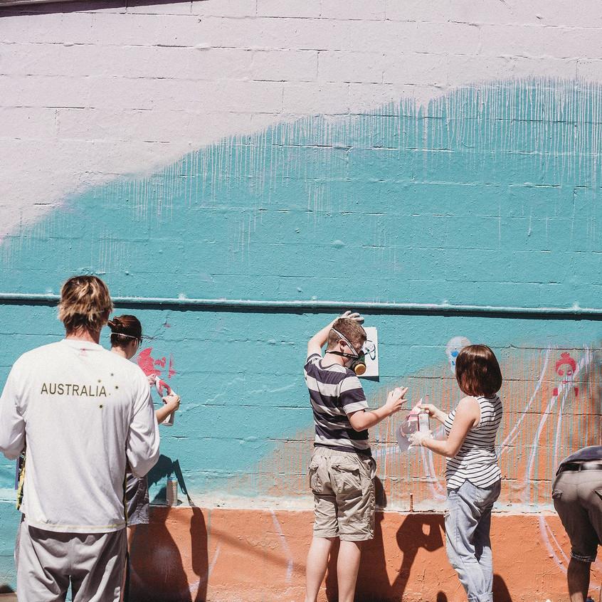 Participants spraying stencils