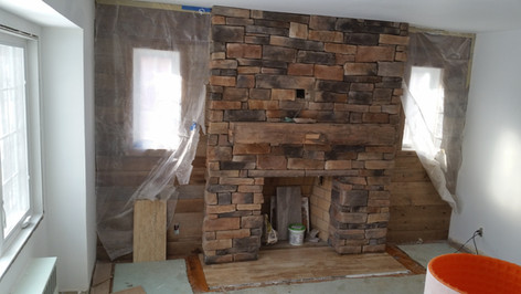 stacked random stone fireplace with travertine hearth