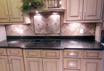 Multiple sized ceramic tile on diagonal with centerr piece