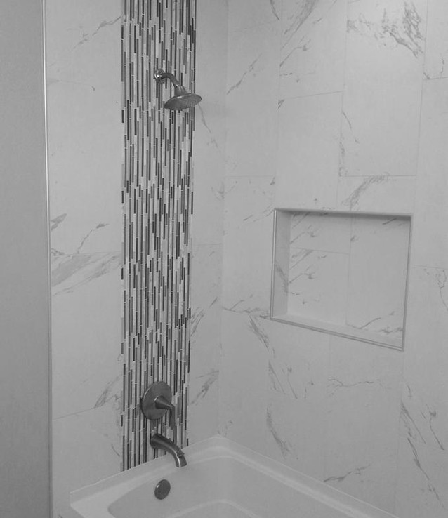 porcealin tile and niche in tub area