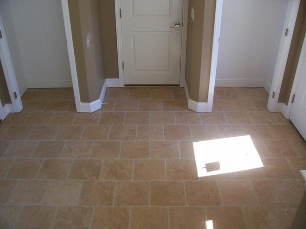 open face travertine mudroom