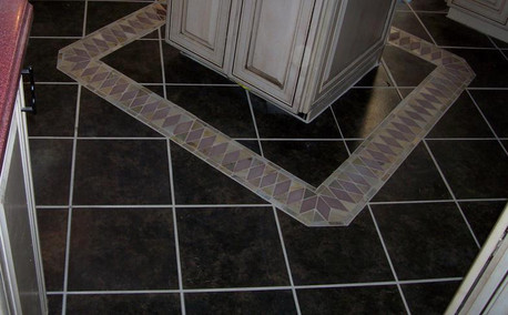 Ceramic tile on diagonal with accent stripe.