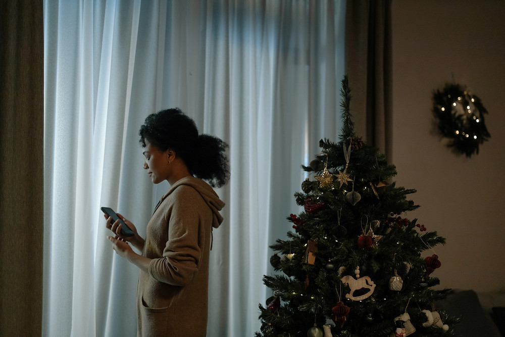 Lonely woman during the holidays with Christmas tree