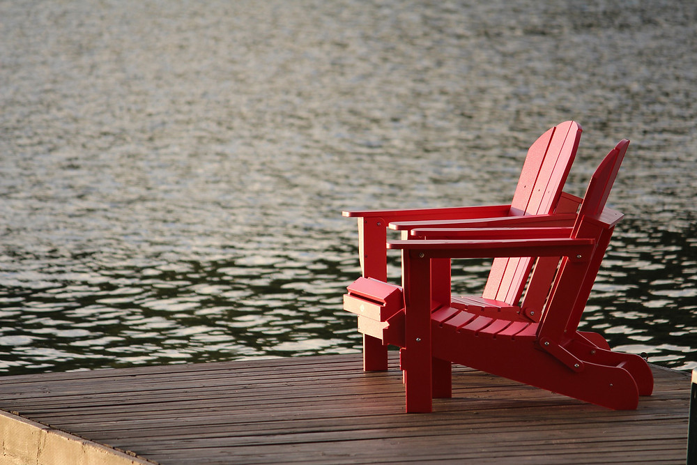 relaxing chairs by the water