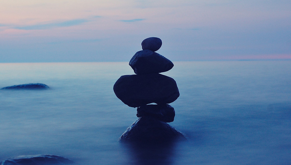 Stones balanced by the water