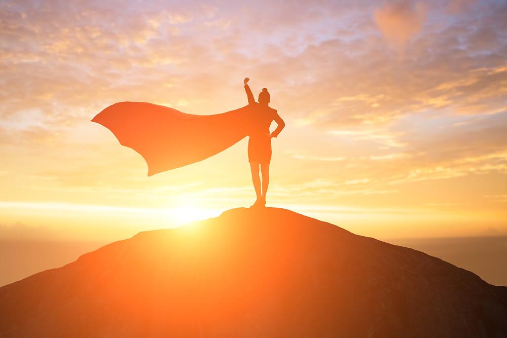 Superhero woman on mountain
