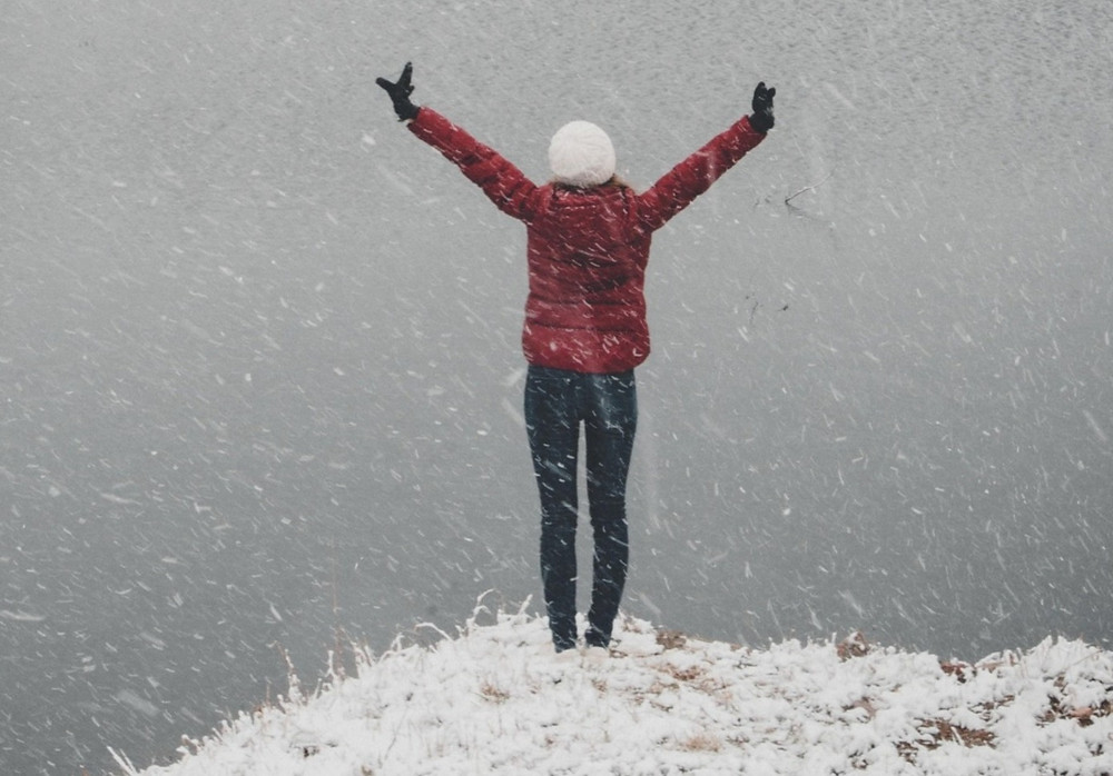 Victorious happy woman in winter