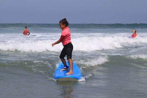 del mar surf camp little girl surfing.jp