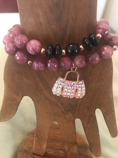 Stack in mauve and black