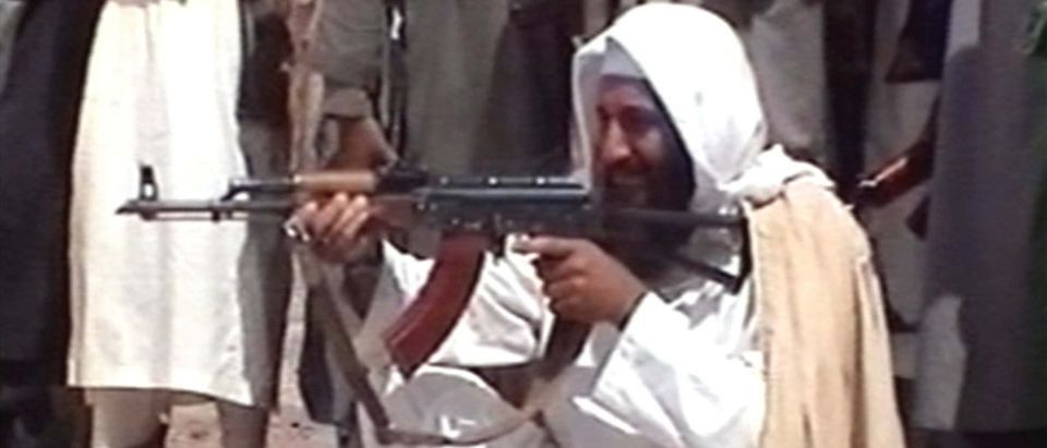 Fig.1.1. Usama Bin-Ladin with an Izhmash/Izhevsk produced Russian 7.62×39mm AKM converted to a side-folder (Source: ARES ConMat)
