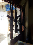 AK Rifles Hanging In Arms Dealership Windowfront   Landi Kotal, FATA, Pakistan