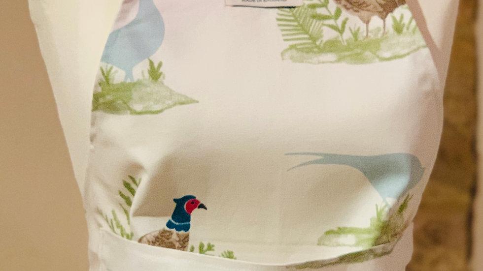 Cocky-locky cotton apron.