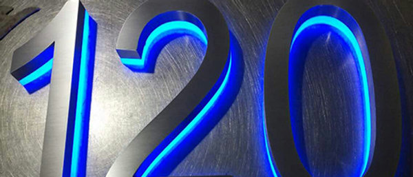 Modern brushed stainless steel channel letter RGB reverse lit house number