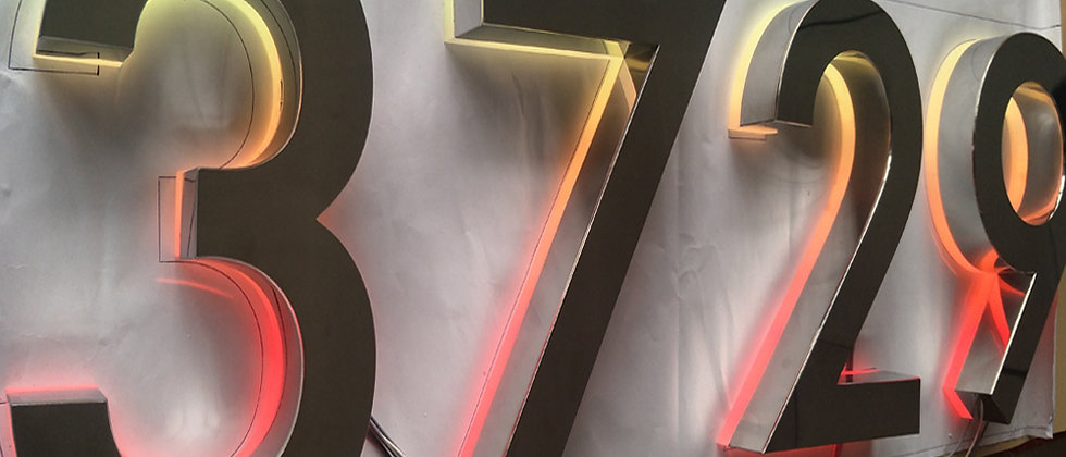 Stainless steel reverse lit channel letters RGB apartment door numbers