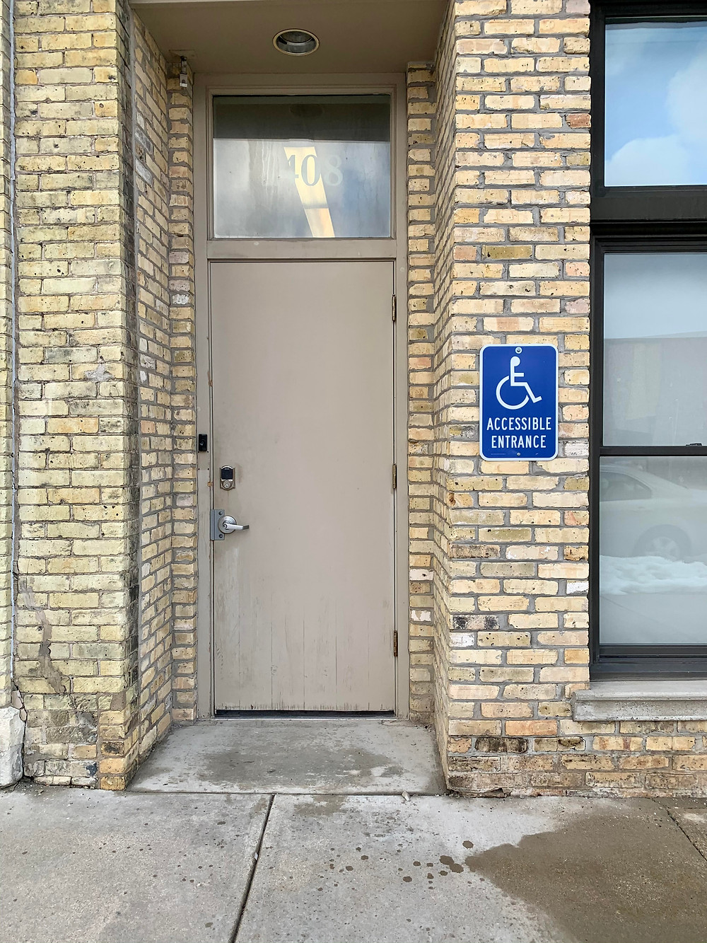 Image description: Accessible entrance at AWP Campus (door is located at 1408 N. 5th St.).