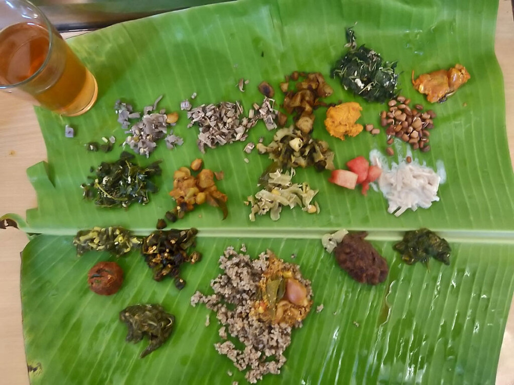 South Indian vegetarian meal platter with 20 items all cooked in traditional methods.
