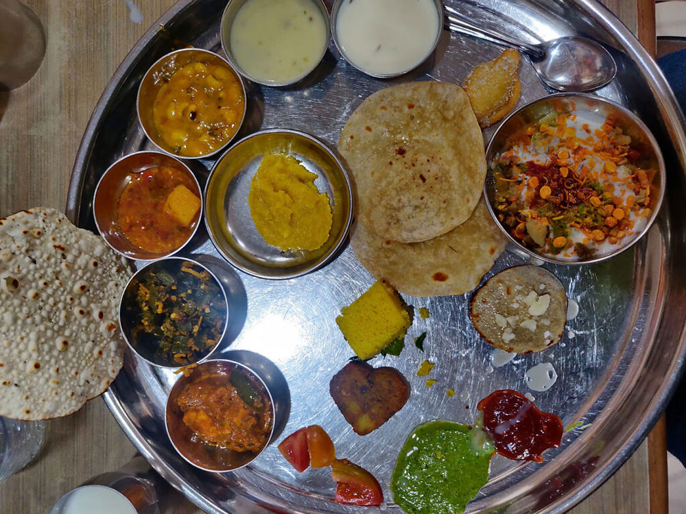 Gujarati meal with 3-4 curries rice and bread