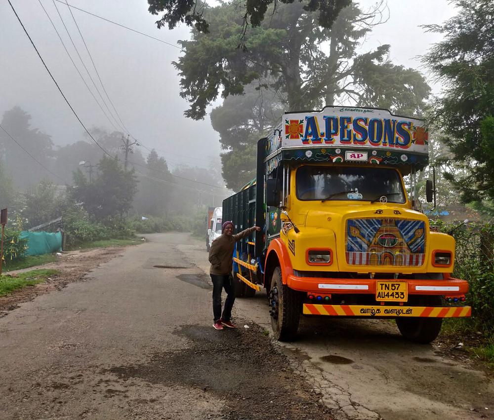 Raghav leaning on truck on a morning walk