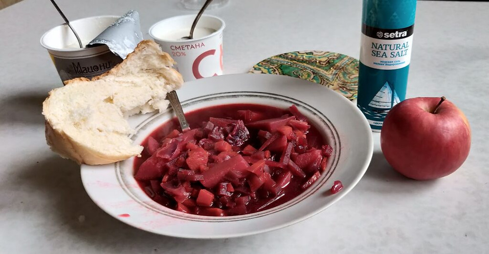 Home cooked meal of Borscht, bread and sour cream