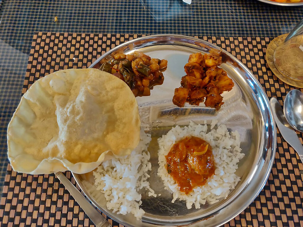 A traditional vegetarian chettinad meal platter at Chettiyar mansion, Kanadukathan