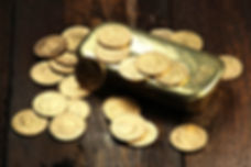 swiss vreneli gold coins and a gold ingo
