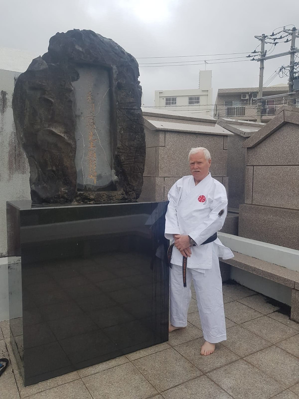 Sensei C. Hunter visits the monument of Master Anko Itosu in Okinawa