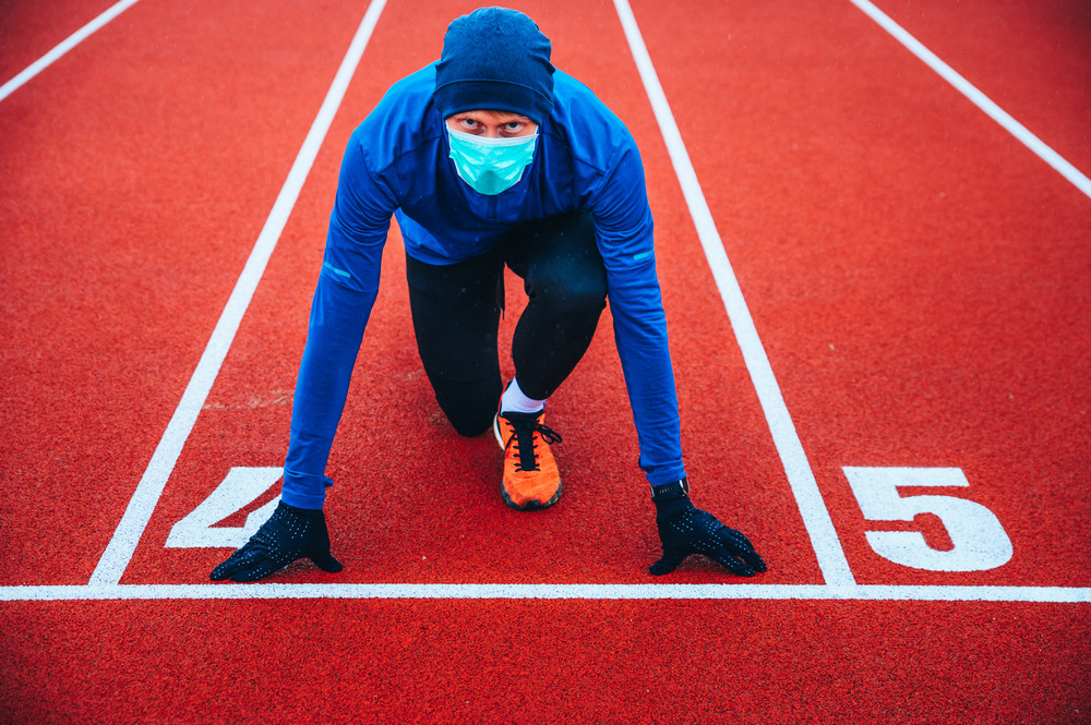 runner at track with a mask on
