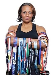 Tekemia Dorsey holding her medals